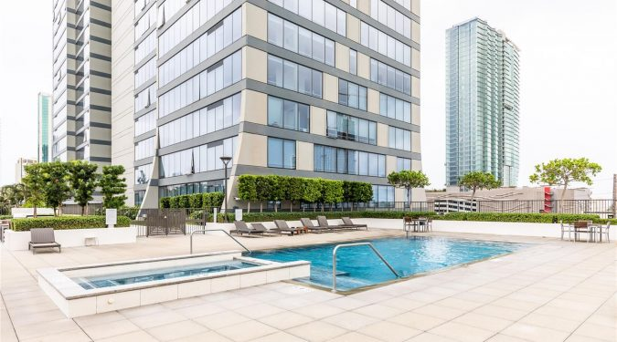 Outdoor pool and lanai area of Pacifica, a 2 beds / baths condo listing on behalf of Lace Kashimoto of Aloha Pacific Premier Realty